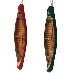 "Set of 2 hand-painted, realistically reproduced vintage-look wooden canoes. They even have paddles! One red, one green as shown. Jute hangers. Sold only as a set of 2. Dimensions: 7.25"" H x 1.25"" W x"