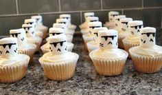 Save money on a Star Wars cake by putting Stormtrooper marshmallows on top of cupcakes.