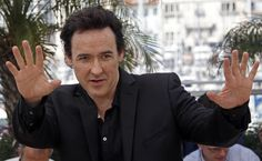 "John Cusack poses during a photocall for the film ""The Paperboy"" by director Daniels in competition at the 65th Cannes Film Festival"