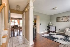Traditional Hallway with High ceiling, Daltile Brixton Bone BX01 Ceramic Tile, flush light, limestone tile floors