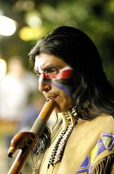 Native American playing an NAF