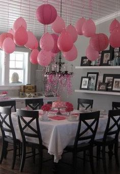 hanging ballons- cheaper than lanterns. place a marble in each before blowing up (or a glow stick..?!?)