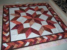 carpenter star with braid border - been wanting to try both patterns, now I can combine them! Amische Quilts, Batik Quilts, Mini Quilts, Star Quilt Blocks, Star Quilt Patterns, Star Quilts, Half Square Triangle Quilts, Square Quilt, Quilting Projects