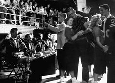 The sock hop was an informal sponsored dance at American high schools, typically held in the high school's own gym or cafeteria. Socks were worn because shoes damaged the gym floors.