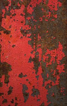 red paint gradually replacedby a deeper organic texture of ochre rust