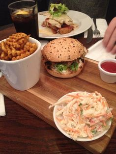 Chicken burger with criss cross fries and coleslaw on happy Monday at The Slug and Lettuce, Manchester