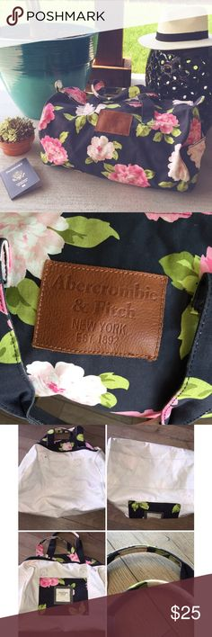 A & F   D u f f l e   B a g Navy blue & pink floral A&F canvas duffle bag. Approx meansurements 19.5 inches long 13 inches high and 10 inches wide/deep. Side pockets, and one big pocket inside. Was used maybe 3x in excellent condition. I love this bag because it's canvas material so you can fit a lot of things in here. A couple of small marks due to being used but could be removed with Shout. Abercrombie & Fitch Bags Travel Bags