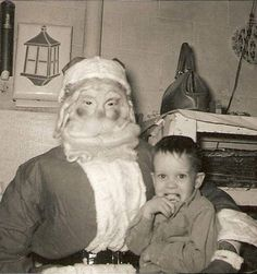 This kid's face says it all: | 23 Disturbing Santa Claus Photos That Will Wreck Your Christmas
