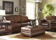 This Vintage Autumn collection will give your space a sleek look. Antiqued top–grain leather with nailhead trim and self–welting give this collection an added touch of grandeur.