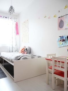 Whimsical Kids Room Make your child's space feel very Whimsical by adding a fun lighting fixture and cute bunting to the wall!  Image Credit: Baby Ramen