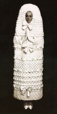 REALLY STRANGE WEDDING DRESSES  Yves St Laurent Wedding Dress 1965 inspired Russian Babushka Doll but it really just looks like a fancy tampon.
