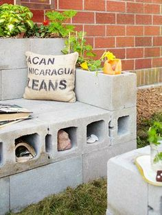 Cinder block bench/chair for yard...can plant things in it...has storage space ...just add cushions