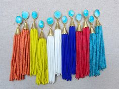 These earrings are such a fun statement! The beaded texture and fun colors dress up any outfit!    Stud post are gold plated, and tassels