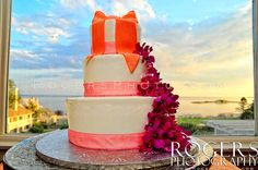 Simple round tiered cake overlooking Long Island Sound. - Rogers Photography