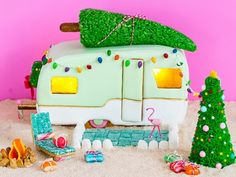 If you think a regular old gingerbread house is nifty, wait until you see Sugar and Cloth's surfy version that includes a caravan, rainbow light...