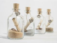 "Message in a bottle style ""save the date"" invitations, perfect for weddings"