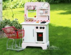 Recycled nightstand becomes a play kitchen (includes an oven, fridge, it's own window with valance.