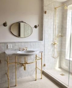 Glazed Zellige tiled with exposed brass components. Master bath.