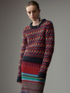 A vibrant Fair Isle sweater in a tactile wool and mohair blend. The warming, Welsh-knitted layer is edged with ribbing.