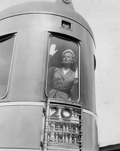 Mrs Mary Phipps 1951 photo by Constantin Joffe    Standing at the window of the train '20th Century Limited'.