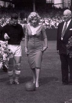 Marilyn Monroe giving an honorary kick at the soccer game between USA and Israel. May 12, 1957.