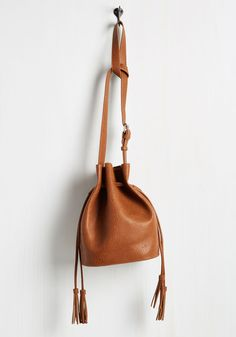 Worth the Tassel Bag in Chocolate. Slinging the strap of this brown bag over your shoulder, you realize how worthwhile your search for the perfect accessory has been! #brown #modcloth