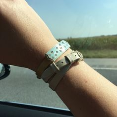 Wearing the starred bar slide on a gold strap and double wrap strap with diamond buckle.