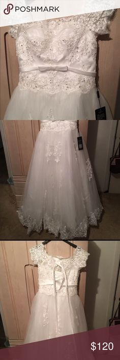 White Wedding Dress MEDIUM Beautiful white wedding dress. BRAND NEW WITH TAGS.  NO train. Says large fits like a medium. Can fit 10/12 and maybe a 14.  Has corset back. Sleeves are off shoulder. Dresses Wedding
