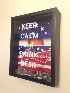 DIY Bottle Cap Display. Made with a shadow box and decals from Michaels. Background cut from 30-pack cardboard beer case.