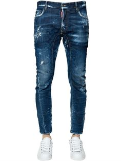 DSQUARED2 - 17CM TIDY BIKER COTTON DENIM JEANS - JEANS - BLUE - LUISAVIAROMA - Button closure with logo tag. Intentionally destroyed, faded, patched and splatter painted areas may vary . Varying internal seams are not to be considered defects, but add value and unique character to the jeans. Five pockets. Day Dream wash. Tidy Biker fit. Length: 95cm. Rise: 22cm . Hem: 17cm. Sample size: 48