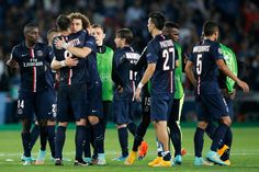 David Luiz and Thiago Motta of PSG embrace as they celebrate victory in the Group F UEFA Champions League match between Paris Saint-Germain v FC Barcelona held at Parc des Princes on September 30, 2014 in Paris, France.