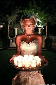 Gorgeous photo of the bride lit up by candlelight I love this! #Bride #Wedding