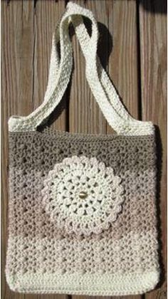 Not only is the Striped Ombre Tote Bag super cute and stylish, but it's a great stashbuster crochet pattern, too. Grab any 5 colors of yarn you have lying around and make this crocheted bag today. This roomy tote measures 15 inches wide by 14 inches