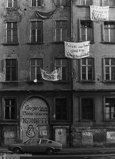 "The destruction of affordable housing in the name of aggressive urban renewal and the construction of anonymous concrete buildings in Berlin's Kreuzberg neighborhood led to the development of a strong squatters' movement at the end of the 1970s. Under the slogan ""Better to renovate through squatting than to destroy through ownership,"" empty apartments were occupied and turned into centers of oppositional subcultures."