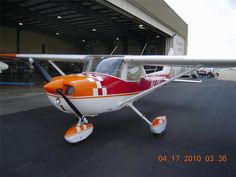 The paint on this 1975 Cessna 150 Aerobat looks factory fresh. An iconic color scheme with red and orange checkerboard pattern.