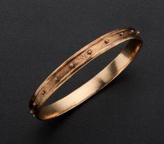 A gold bangle bracelet.