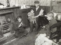 This photograph entitled 'Convicts home in Bethnal Green' shows an elderly man looking after his Grandchildren whilst the mother goes out to work as a domestic cleaner. She is the sole breadwinner in the family as her husband is in prison. London 1800, East End London, Old London, Victorian Parlor, Victorian London, Vintage London, Victorian House, Photos Du, Old Photos