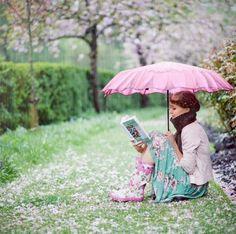 reading in the rain, .just reading in the rain Spring Shower, Under My Umbrella, Pink Umbrella, Umbrellas Parasols, Woman Reading, Children Reading, Reading Books, Spring Fever, Spring Has Sprung