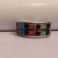Vintage Sterling Native American ring Vintage multi stone Sterling Native American ring. Stones consist of Malachite, Opal, Onyx, Spiny oyster, Lapis, Turquoise, and Charoite. The one malachite stone has a tiny chip in corner (see pic 3). Ring is signed SF 925 and is a size 7 Vintage Jewelry Rings