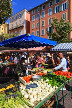 """Cours Saleya, Nice - """"Vieille Ville off the Promenade des Anglais as it turns into the Quai des Etats-Unis, Open nearly every morning (Tuesday through Sunday). Get there early (a little past 6 a.m.). Or by 8 or 9 a.m., you'll have to contend with the masses. Bring small bills to pay the vendors, and you should also bring a bag to tote your finds. You should also keep in mind that the Cours Saleya is free to enter, but the prices for specific fruit, flowers, and veggies can be a bit high."""""""