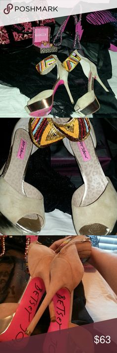 Betsey Johnson high heels Betsey Johnson high heels..these are so heels are absolutely beautiful, show stopping!! They are a light tan suede with gold heels that are very high.they zip up in the back.there is very beautiful detailed multicolored beading at the top.these are one of a kind shoes.there is very minor wear normal for shoes as you see in pics they still look great.my price is firm.no low balling.these shoes are fabulous Betsey Johnson Shoes Heels