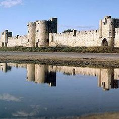 The towers and ramparts of Aigues Mortes - well worth a visit for the view over salt pans in one direction and pretty canals in the other. In summer this place sweats. Find Restaurant le Minos on Place Saint Louis and order their rouille - it's superb.