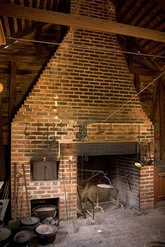 Beautiful cooking hearth fireplace with a brick oven. Yes please!