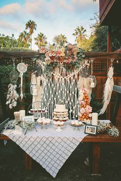 Bohemian backyard wedding dessert table