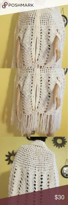 """Vintage 60s White Crochet Poncho 1960's White Crochet Poncho.? 6 Button Down Front 2 Side Arm Slits 100 % Virgin Acrylic Length: 37"""" Includes Aprrox 9"""" Bottom Fringe Label: English Village Fits Size Med - Large Perfect ! Excellent Condition ! Enjoy ! Vintage Other"""