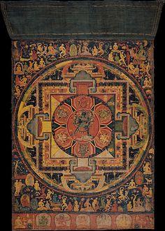 """""""Este mandala, o diagrama ritual, se concibe como el palacio de la Chakrasamvara iracundo y su consorte Vajravarahi.Las divinidades centrales están rodeadas por seis diosas, cada grupo en un pétalo de loto estilizada que forma un vajra. El mandala es una de las primeras pinturas de gran formato para sobrevivir de Nepal. Características estilísticas relacionar este cuadro a Nepal manuscrito cubiertas y oriental indio de palma ilustraciones de manuscritos del siglo XII."""""""