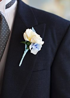 White Boutonniere with a little bit of blue for Ryan?
