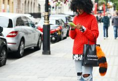 Julia Sarr-Jamois busting out a smile...and why not! Chanel in hand, looking über fly and I'd say in Paris. happy days. Dose of happy smiles on the streets courtesy of #LeandraMedine