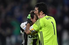 Gianluigi Buffon (R) and Stephan Lichtsteiner of Juventus FC celebrate victory at the end of the Serie A match between Juventus FC and AC Milan at Juventus Stadium on March 10, 2017 in Turin, Italy.