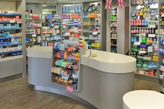 Pharmacy dispensary design and over the counter shelving and storage solutions. Shop Counter Design, News Design, Design Ideas, Pharmacy Design, Cosmetic Shop, Book Cafe, Ceiling Design, Receptions, Storage Solutions
